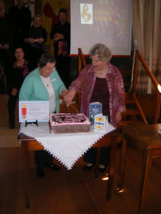 Edna Peel & Norma Taylor cut cake