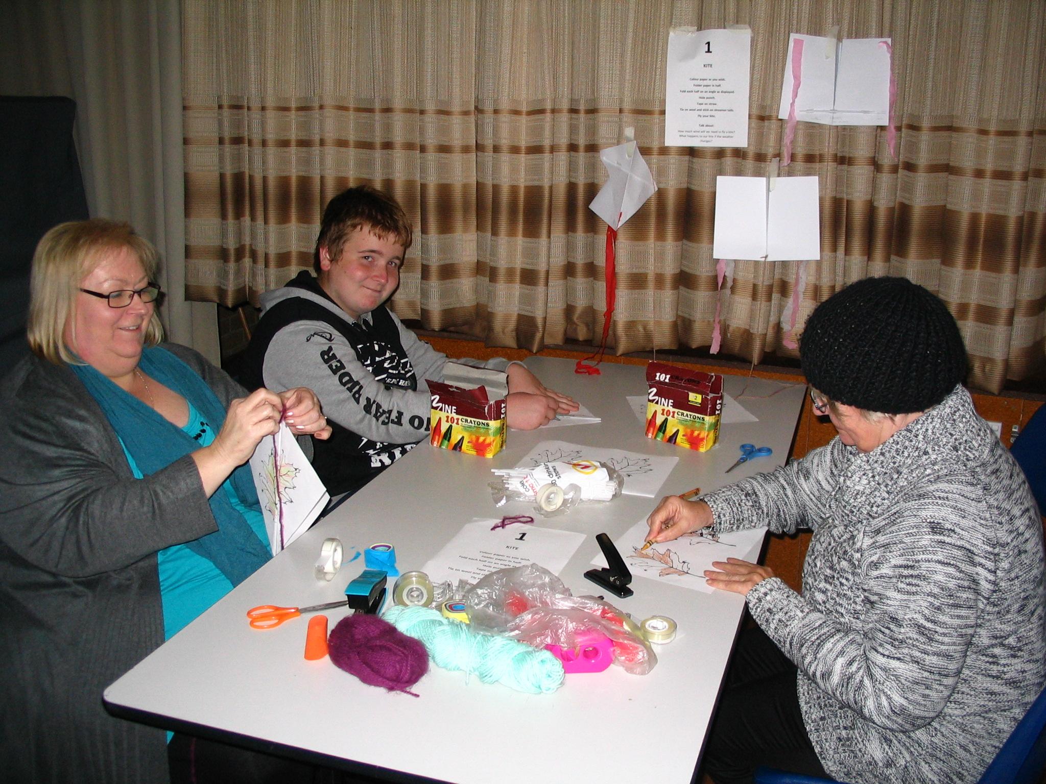 Julie, Riley & Denise making kites
